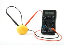 Bio battery. Lemon measuring voltage Royalty Free Stock Photos