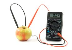 Bio battery. Measuring voltage in the apple Stock Images