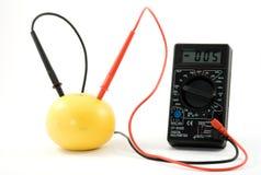 Bio battery. Measurin voltage in frapefruit Royalty Free Stock Photos