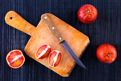 Bio bloody oranges cut in half on a plate. Stock Images