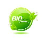 Bio- bottone del prodotto con le foglie verdi e le gocce di acqua Fotografie Stock Libere da Diritti