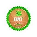 Bio- bottone del prodotto, foglie verdi Immagini Stock