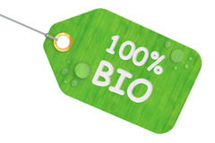 100% bio concept, green tag. 3D rendering. On white background Stock Photos