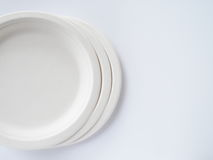 Bio degradable plate on white background Stock Images