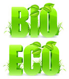 Bio and Eco words. Green Bio and Eco words, with fresh leaves and grass Stock Photos