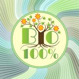 100% bio emblem with tree in blossom on green wavy background, etiquette for natural ecologic products from ecology agriculture. Vector eps10 Stock Photo