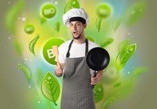Bio- foglie concetto e ritratto del cuoco fotografie stock libere da diritti