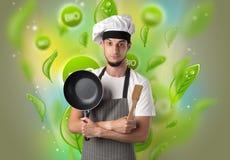 Bio- foglie concetto e ritratto del cuoco fotografia stock