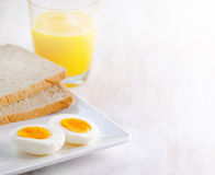 Boiled egg, toasts and orange juice Stock Image