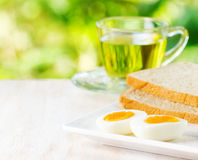 Boiled eggs, toasts and cup of tea Royalty Free Stock Photo