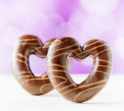 Chocolate hearts on purple backgroud Stock Photography
