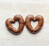 Chocolate hearts on white wooden table Royalty Free Stock Image
