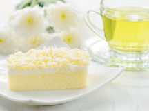 Cup of herbal tea and fresh cake Royalty Free Stock Image