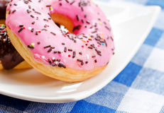 Fresh donuts on nature background Royalty Free Stock Photography