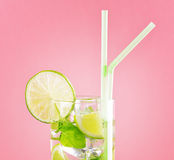 Glass of mojito cocktail on pastel pink background royalty free stock photos