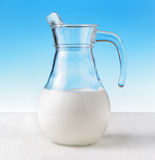 Jug of milk on sky background Stock Image