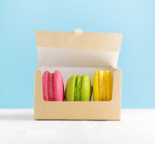 Macaron box on white wooden table Stock Image