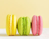 Macaron on white wooden table Royalty Free Stock Photo