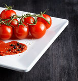 Ripe tomatoes and tomato paste. Ketchup making Stock Photos