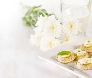 Several canapes and glass of milk Royalty Free Stock Image