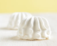 White marshmallow on wooden table Stock Photos