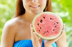 Young woman with watermelon in hands Stock Photography