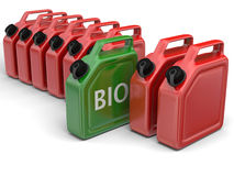 Bio fuel. Green bio fuel jerry can in between red canisters on white background royalty free illustration