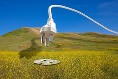 Bio Fuel Renewable Energy Concept. Clean renewable bio energy concept: large white power cord arching across a blue sky and diving down into an electrical plug royalty free stock images