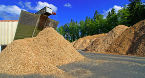 Bio fule (biomass) storage of against blue sky Stock Photos