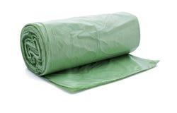 Bio garbage bag. Green garbage bag- bio in a roll Stock Photo