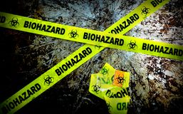Bio haz. Yellow biohazard tape on grunge background Stock Photography