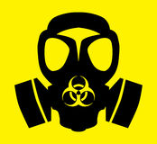 Bio hazard gas mask symbol. A bold black drawing of a gas mask and bio hazard symbol on a bright yellow background Stock Images