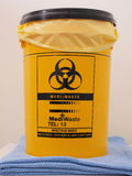 Bio Hazard labled yellow specialist collection container. As used in first aid rooms, Melbourne 2015 royalty free stock image