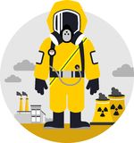 Bio hazard protection concept. Man in protective suit and gas mask on pollution background Stock Photos