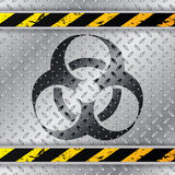 Bio hazzard warning sign on metallic plate. With triped warning sign Royalty Free Stock Images