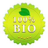 100% bio label. 100 percent bio badge on white background with leaflets Royalty Free Stock Photos
