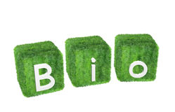 Bio-logo isolated on white background. Fully 3D-rendered logo with letters on grass covered boxes isolated on white background Royalty Free Stock Photography