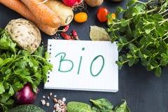 Bio organic vegetables frame with bio note, carrots, parsley, mi Stock Photo