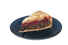 bio pavot bleu de plaque de cerise de gâteau aigre Photographie stock