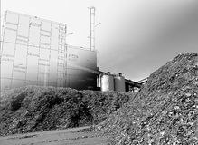 Bio power plant drawing  and storage of wooden fuel against blu Stock Photography