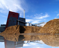 Bio power plant with storage of wooden fuel Stock Photography