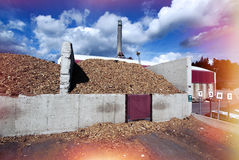 Bio power plant with storage of wooden fuel Royalty Free Stock Photos
