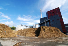 Bio power plant and storage of wooden fuel (biomass) against bl Stock Photo