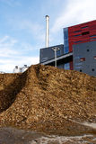 Bio power plant and storage of wooden fuel (biomass) against bl Royalty Free Stock Photo