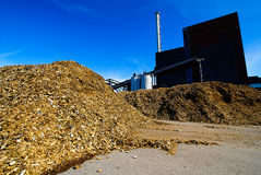 Bio power plant storage of wooden fuel (biomass) against bl Stock Photos