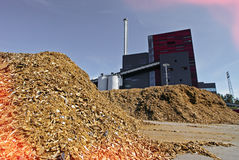Bio power plant with storage of wooden fuel biomass Stock Photography