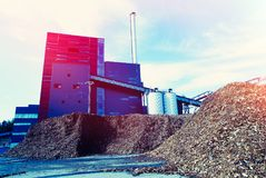 Bio power plant with storage of wooden fuel biomass against bl. Ue sky Royalty Free Stock Image