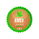 Bio product button, green leafs Stock Images