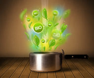 Bio signs coming out from cooking pot Royalty Free Stock Photos
