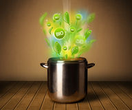 Bio signs coming out from cooking pot Stock Photo